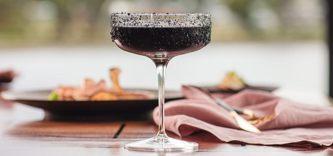 Close up shot of a dark coloured cocktail