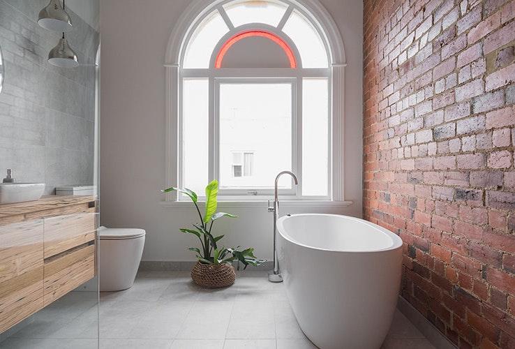 Historic exposed brick in the bathroom.