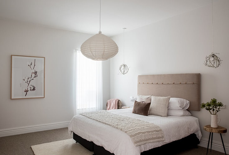 Natural colours and textures in the master bedroom.
