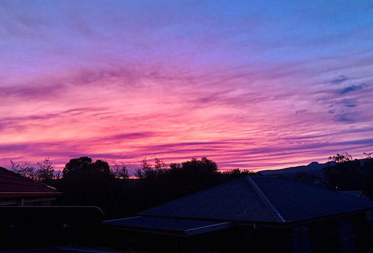 Sunset in Kingston creating a purple and pink sky