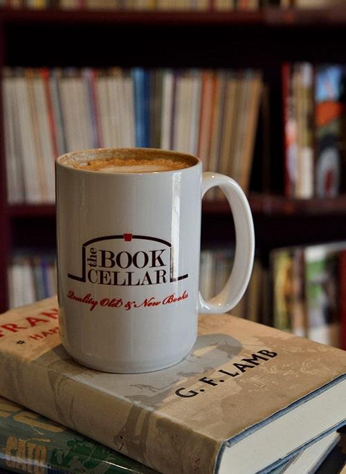Coffee mug sitting on a stack of books
