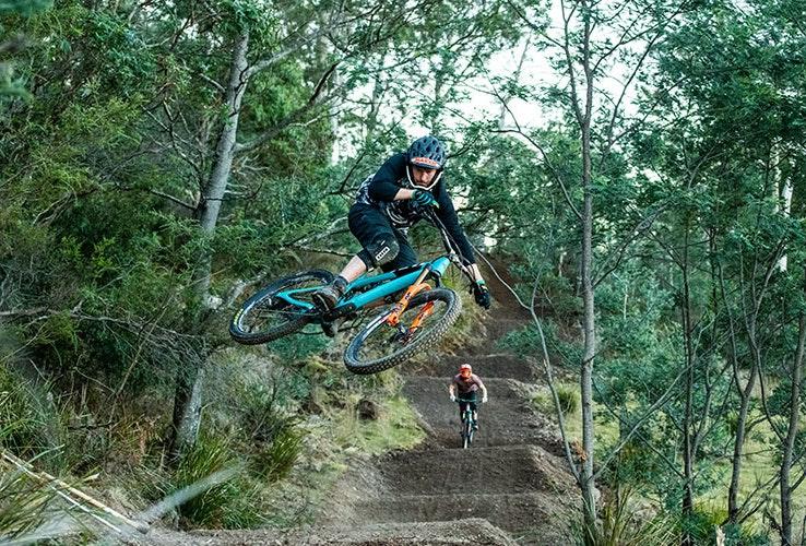 Man doing a jump on a mountain bike