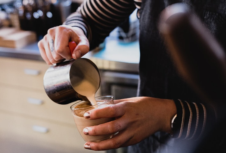 Person making coffee at The Chapel
