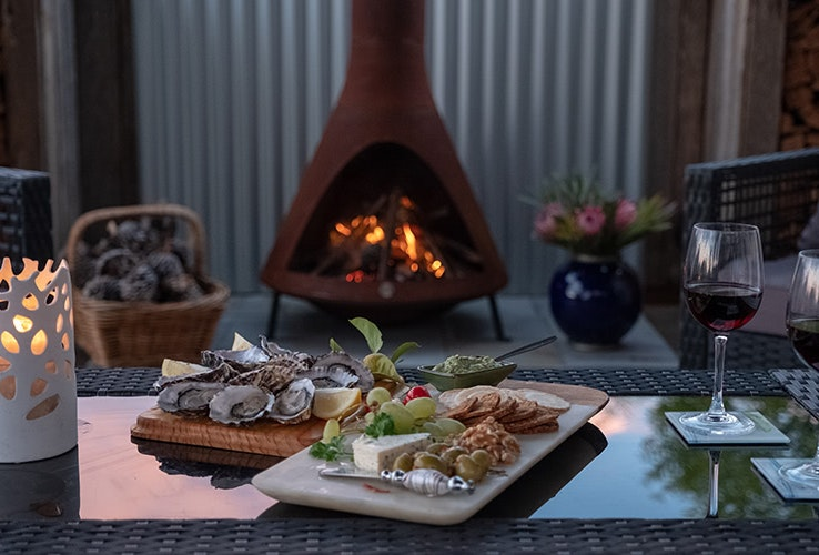 Fire pot, wine and food at Tully Cottage
