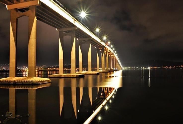 Tasman Bridge lit up at nighttime
