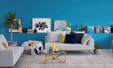 Painted vibrant blue decorated lounge room