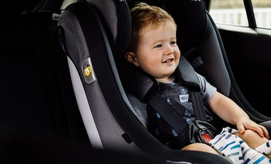 A toddler in a car seat