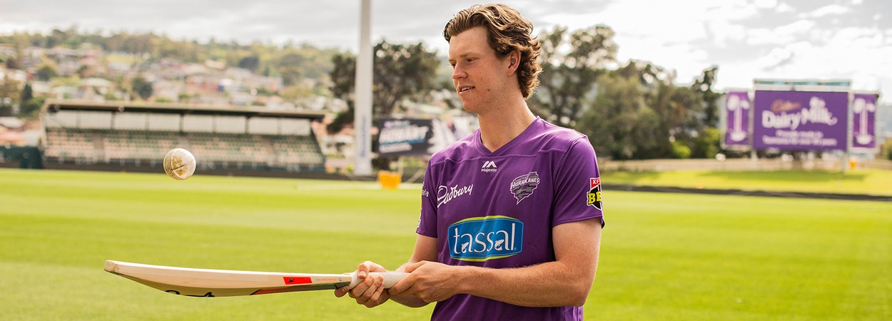 Mitch Owen of the Hurricanes practicing with bat and ball at Bellerive Oval
