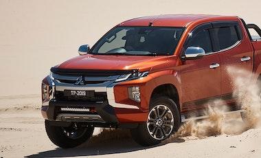 Mitsubishi Triton driving on sand