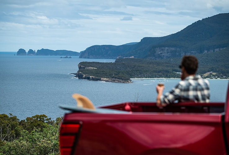 Looking out over Pirates Bay in the red Mazda BT-50