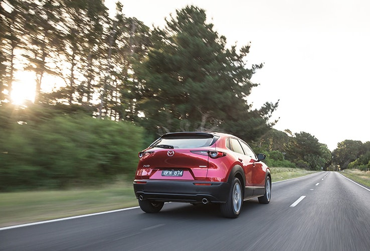 Red Mazda CX30 on highway