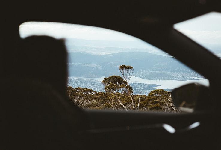 Mountain outlook from car interior.