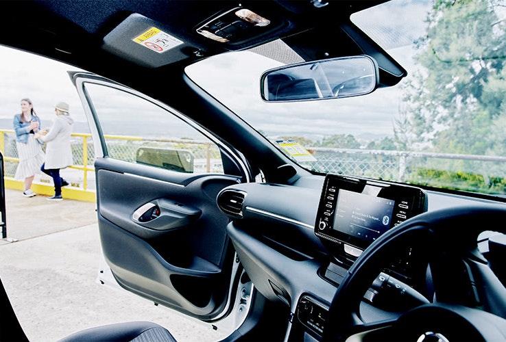 Car interior with door open.