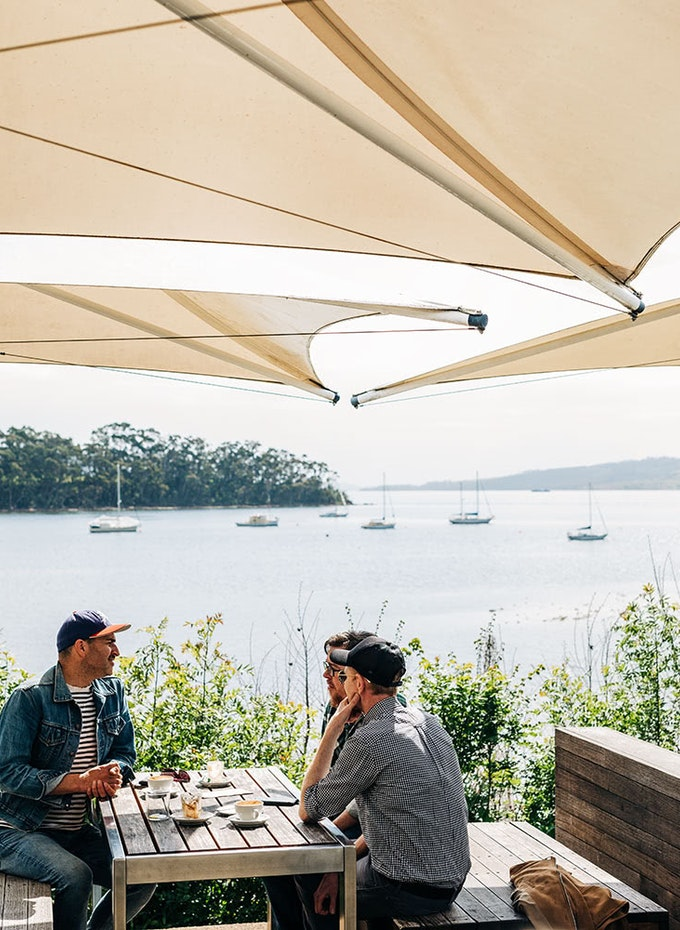 Diners at a waterfront restaurant.