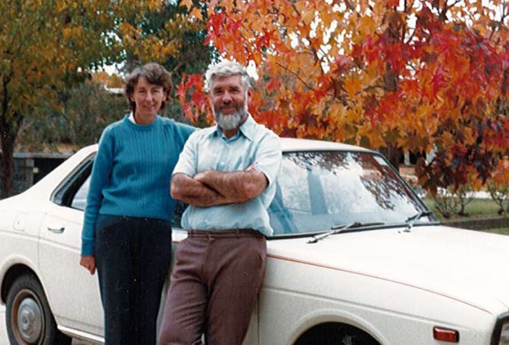 David and Jill Critchlow posing next to their car in 1970