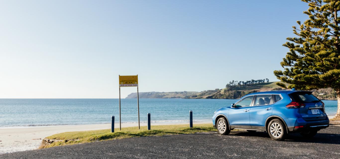 Car parked at beach.