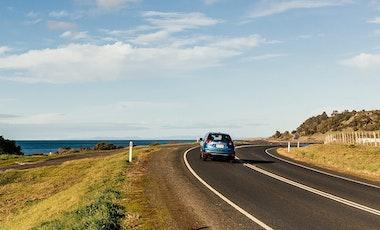 Car driving on scenic coastal road