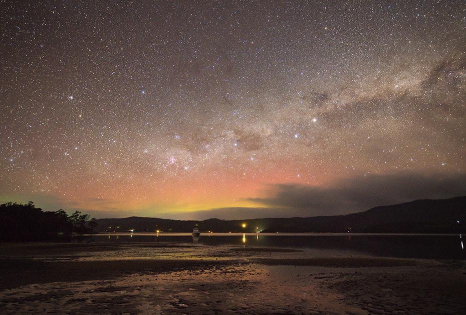 Pink and yellow aurora and stars