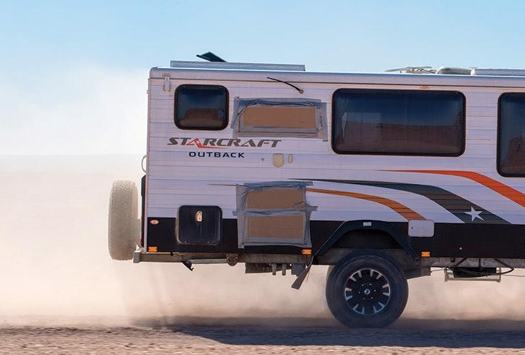 Caravan driving in the dust