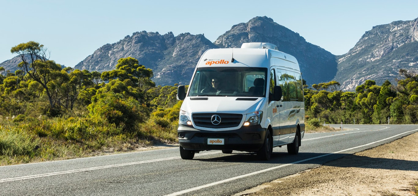 Apollo campervan traveling past Cradle Mountain