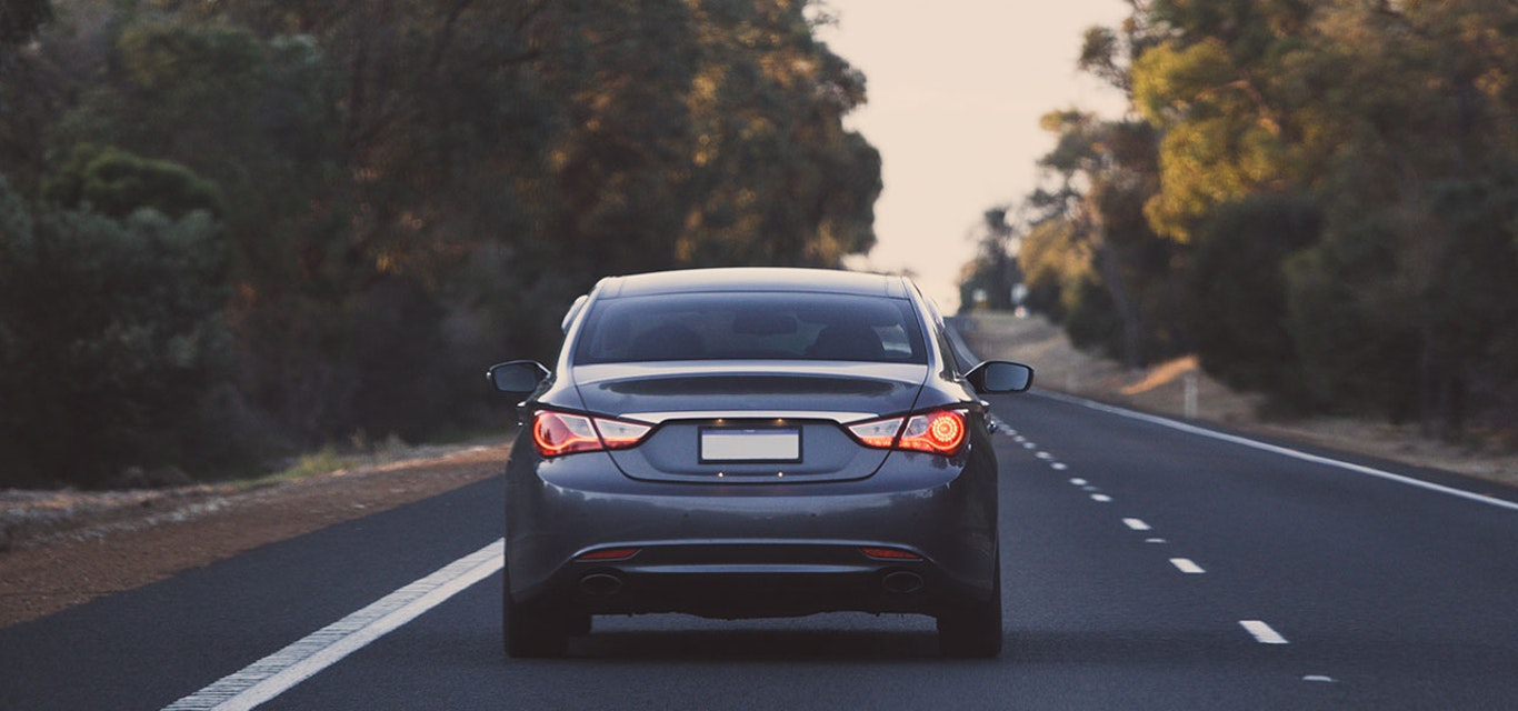 Car driving along road
