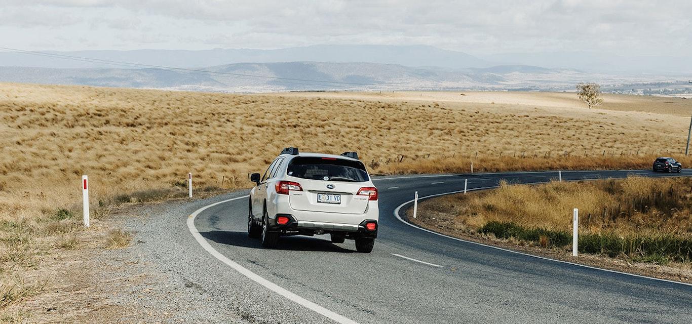 White car on rural road