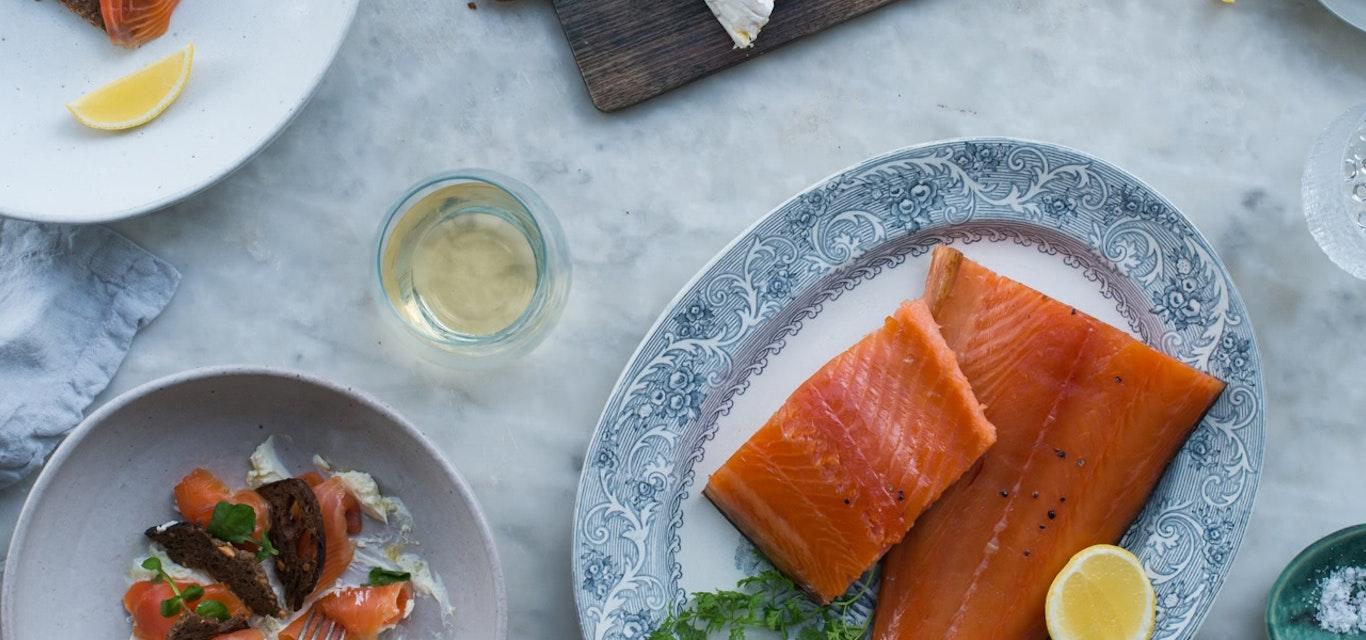 Smoked salmon dish and crockery on table