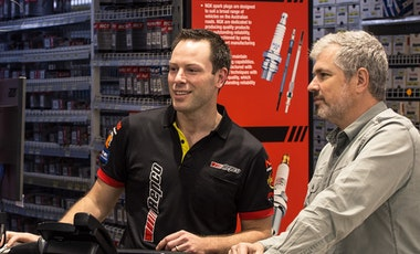 Repco store assistant helping a customer