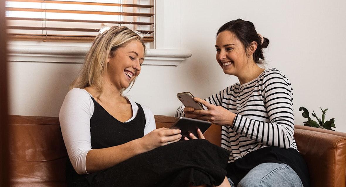 Two ladies on their phones