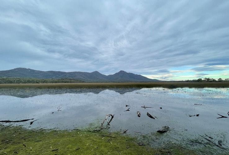 A natural lagoon with mountain views