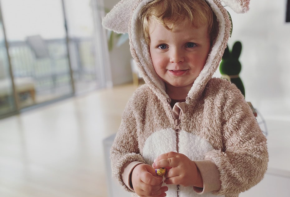Smiling boy dressed as Easter Bunny