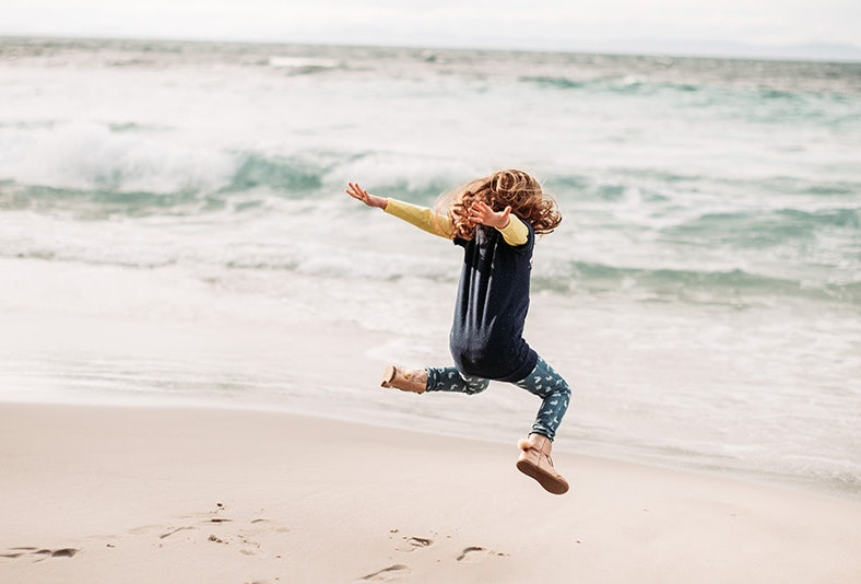 Jumping for joy at Neck Beach, Bruny Island.