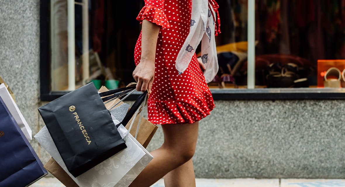 Person carrying lots of retail shopping bags