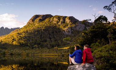 Young couple looking over lake to Cradle Mountain