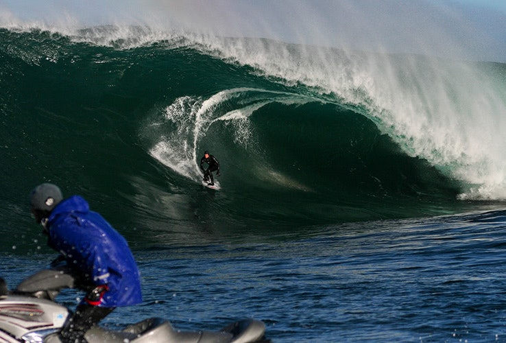 A surfer riding a wave at Shipstern Bluff