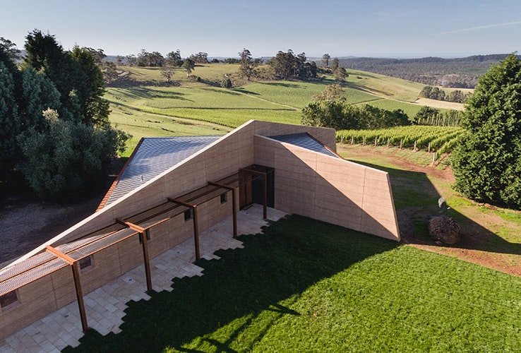 Architecturally designed winery sitting atop rolling green hills