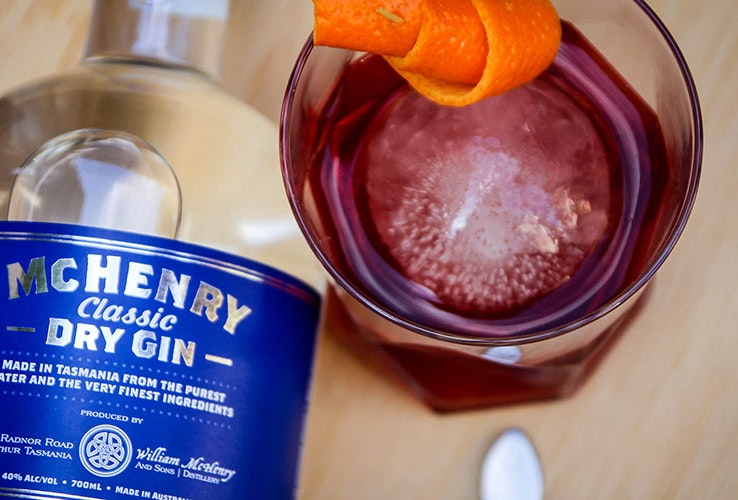 Bottle of McHenry Classic Dry Gin and a glass