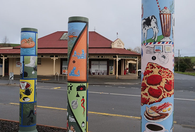 Some colourfully painted posts at the Lilydale town centre