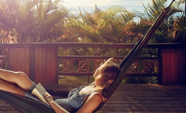 Person reading in a hammock.