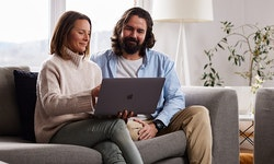 A couple browsing the internet on a laptop together