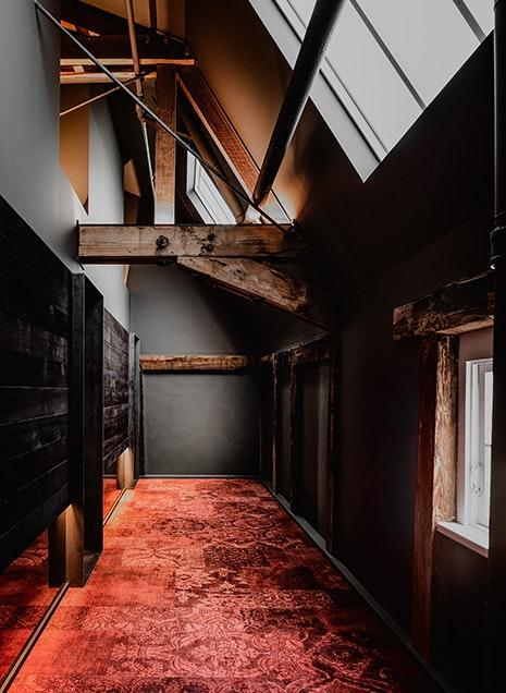 Red carpet hallway at Stillwater Seven in Launceston