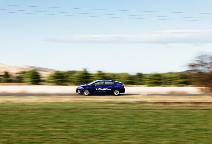 Hyundai Ioniq electric vehicle driving along rural road