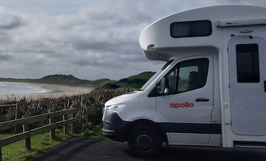 Apollo motorhome parked overlooking a beach