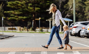 Adult and child crossing street.