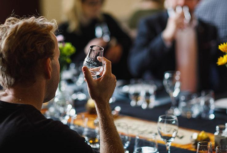 A man enjoying a glass of whisky