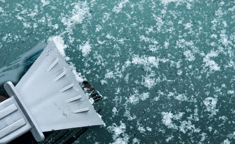 Ice scraper being used on a frosty windscreen