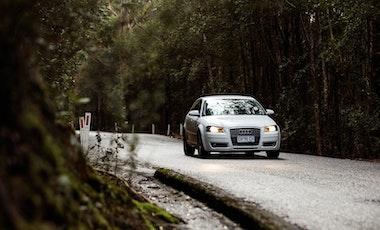White car driving on Tasmanian wintery road