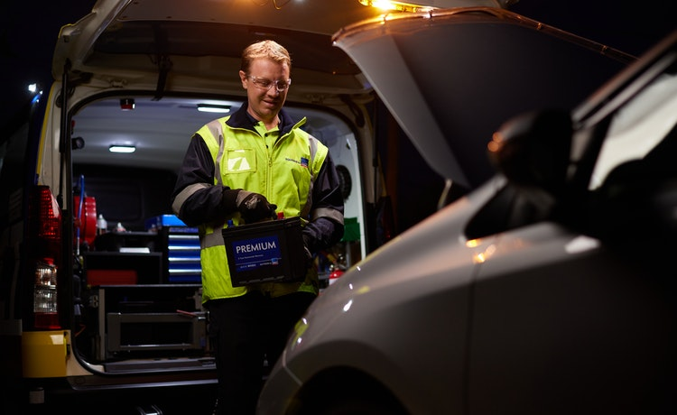 Roadside patrol changing a battery at night