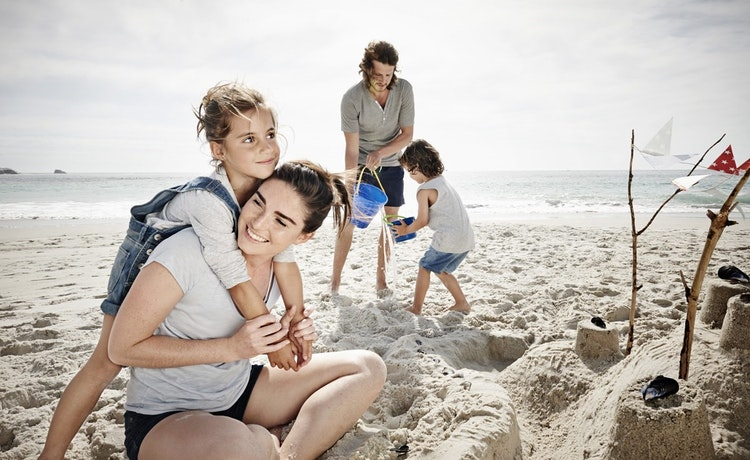 Family and children playing on beach