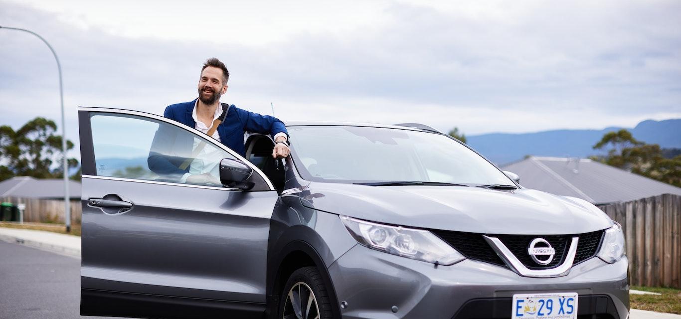 Man standing beside SUV